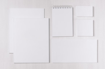 Branding business mock up of white blank stationery set on light soft white wooden background. Template for branding, business presentations and portfolios.