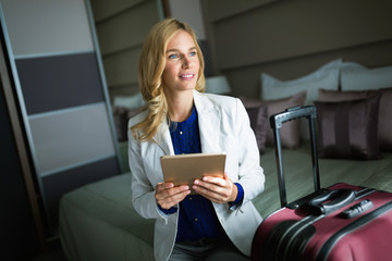 Young attractive businesswoman in hotel room