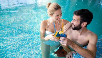 Picture of happy couple relaxing in pool