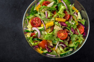 tomatoes, bell pepper, cucumber, lettuce and red onion salad