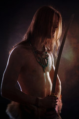 a young naked waist with a man with long hair and a sword in his hands