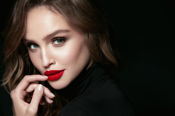 Beautiful Woman Face With Makeup And Red Lips.