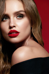 Beauty Makeup. Woman With Beautiful Face And Red Lips.