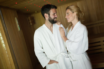 Attractive man and beautiful woman in sauna