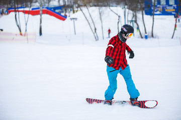 Picture of athlete with snowboard riding in snowy resort