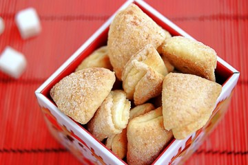 Delicate curd cookies, sprinkled with sugar, in a box