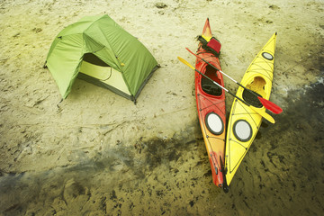 Water trip on kayaks. Camp on the river bank.