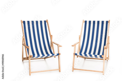 Two Striped Beach Chairs Isolated On White