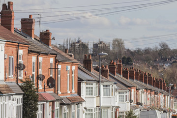 Row of terraced house roofs with chimney stacks