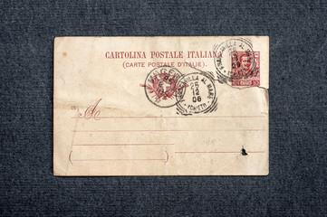 old postcard on dark background