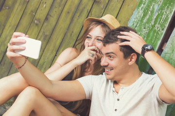 Couple in love doing a selfie outdoors.