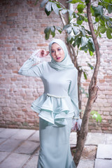 Eid ul-Fitr fashion portraiture.Beautiful muslim girl wearing asian dress with hijab.Hijab Fashion outdoor Portraiture.