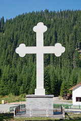 Big cross near an orthodox monastery in Romania