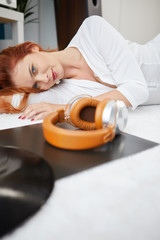 the image of resting sexy woman listening to vinyl