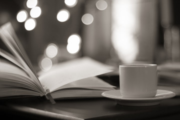 book and coffee with magic bokeh background