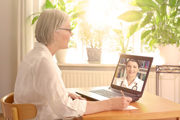 senior woman doctor online consultation