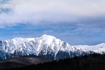 Snow peaks in the cloudy day