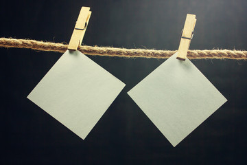 Blank note paper hanging on rope