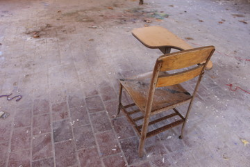 old wooden desk at abandoned school