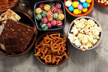 Salty snacks. Pretzels, chips, crackers in wooden bowls.