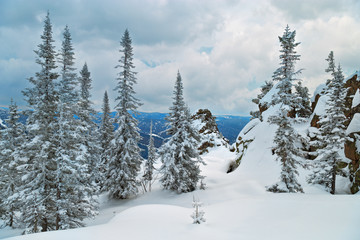 View on the top of the Mount Utuya. Winter forest landscape in Altay Mountains. Siberia, Kemerovo region, Sheregesh ski resort, March 2018.