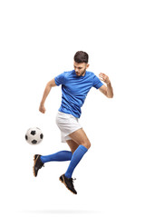 Soccer player doing a trick with a football