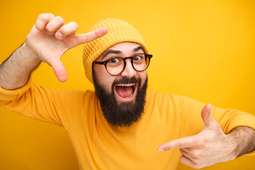 Excited guy taking photo with hands