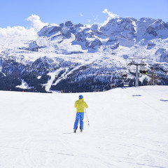 ski slope with skiers in the Alps