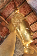 Close up big golden reclining buddha statue in Wat Pho,Bangkok Thailand