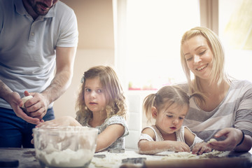 Smiling family in kitchen.
