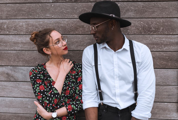 happy Multiracial couple at wooden wall