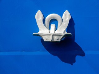Close up of an anchor on a ship's hull.