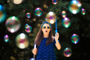 Summer Woman Having Fun Making Soap Bubbles