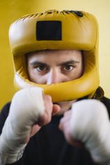 Confident fighter in helmet