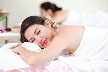 Beautiful young woman relaxing spa salon white light background,Spa concept