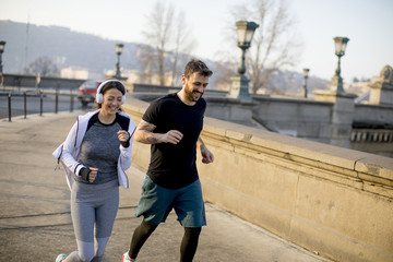 Young couple running in the morning