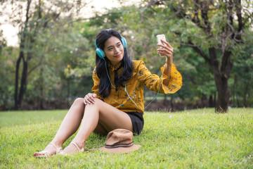 Female bohemian hipster selfie at garden