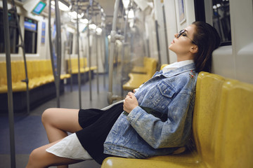 Sexy model is posing in carriage of metro train