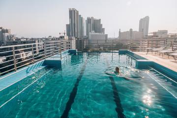 Woman swimming in roof pool