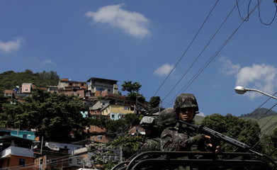 Brazilian Armed Forces patrol during an operation against drug gangs in Lins slums complex in Rio de Janeiro