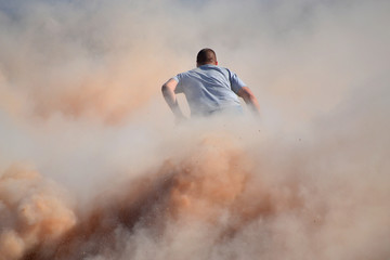 Rider in Dust Cloud