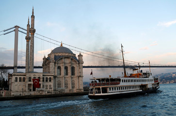 A ferry, with the Ottoman-era Mecidiye mosque in the background, leaves from Ortakoy pier in Istanbul