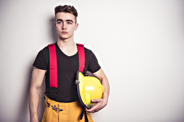 Picture from a young and successful firefighter on studio
