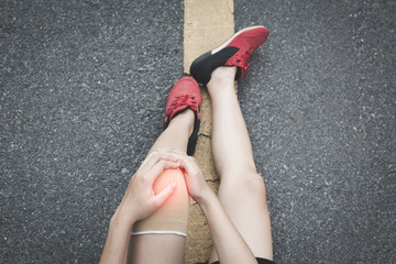 Woman accident during running on the road , color of vintage tone selective and soft focus