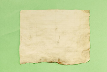 A piece of paper, half worn; a vintage texture surface.