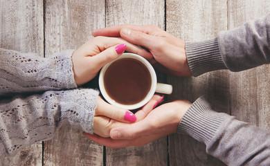 cup of tea in hands. Selective focus.