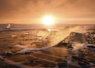 Scenic view of ice on shore against sky during sunset