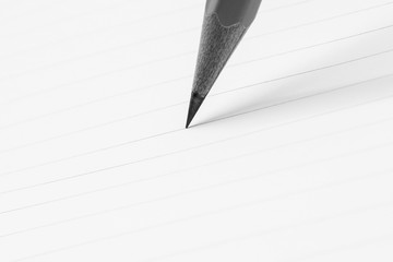 close up of pencil writing on a paper - for business concept