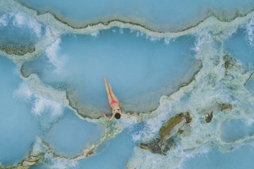 High angle view of girl wearing bikini while relaxing in hot spring