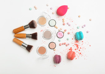 Decorative makeup products on white background